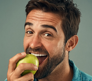 man eating an apple
